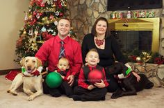 Great family christmas photo in front of tree and fireplace. Large family posing.