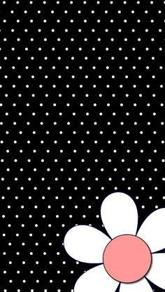 A flower with black & white polka dot background