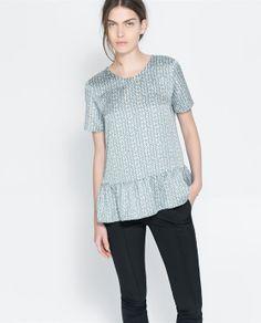 Image 1 de TOP À POIS IRRÉGULIERS de Zara