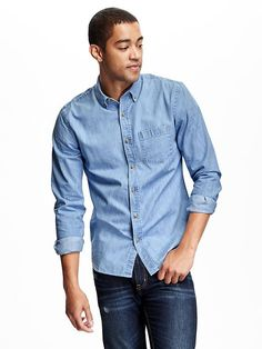 Old Navy Button down collar. Seven button placket. Chest patch pocket. Long sleeves with buttoned cuffs. Shirttail hem. Soft, medium weight chambray. Slim fit through body. Shirt hits below waist.