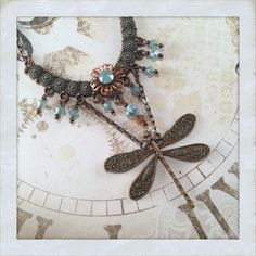 Wings Over the Sea | Raspberry Fields Design Antique copper and rose gold meet in this dragonfly drop necklace with palest blue opal accents.  Delicate chain and rose gold plated clasp.  Miss the garden?  http://raspberryfieldsdesign.indiemade.com/product/wings-over-sea  $47