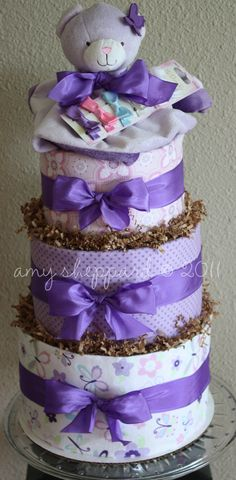 DIY- Diaper Cake Tutorial- great centerpiece for baby shower food table and baby gift!