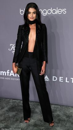 Bold fashion statement: Brazilian model Daniela Braga put on a daring display as she arriv...