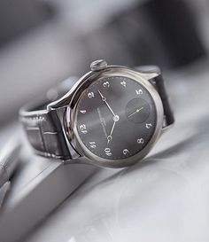 A classic steel @laurent_ferrier Galet micro-rotor with applied Breguet numerals on a brushed grey dial. Landing next week.