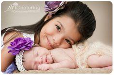 newborn sibling pose