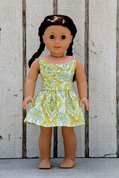 Green and blue pintucked dress by daisychaindolls. Made using the Liberty Jane Boomerit Falls Dress pattern, found here http://www.pixiefaire.com/products/boomerit-falls-dress-18-doll-clothes. #pixiefaire #libertyjane #boomeritfallsdress