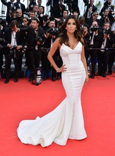 "Eva Longoria looked glamorous in a white gown with a long train at the premiere of ""Saint Laurent"" in Cannes on May 17, 2014."