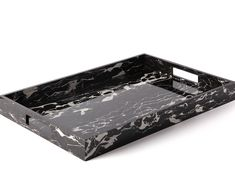 Carla Carstens' large tray with cutout handles is created with a  one-of-a-kind marbled design in simple shades of black and white. Crafted  in acrylic, this tray is a unique way to personalize any space. Style yours  with coffee table books and a vase of fresh-cut blooms.  Dimensions: 20 x 14.25 x 2