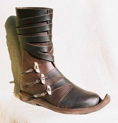 Viking boots with antler buttons. love love love them! Have to find them!