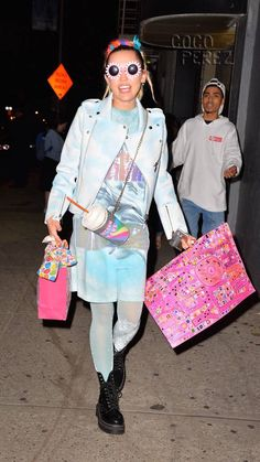 Miley Cyrus Wears A Giant Sippy Cup Filled With 'Unicorn Tears' Around Her Neck In New York City!