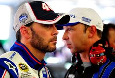 Jimmie Johnson (L), driver of the #48 Lowe's Patriotic Chevrolet, and crew chief Chad Knaus (R) walk in the garage during practice for the NASCAR Sprint Cup Series Coca-Cola 600 at Charlotte Motor Speedway on May 24, 2012 in Concord, North Carolina.