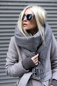 Photos via: FIGTNY Lee hits it out of the park with her all-grey look for winter. Her tortoise print sunglasses and white sneakers give the varying shades of grey a casual cool touch.