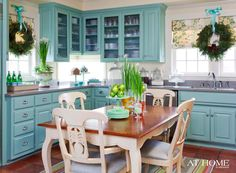 turquoise cabinets, gray countertops and terra cotta floor