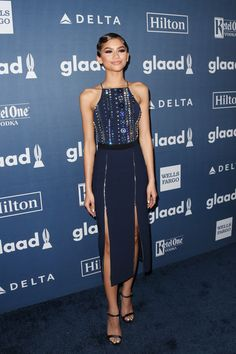 Zendaya Coleman Beaded Dress - Zendaya Coleman looked as stylish as ever at the GLAAD Media Awards in a navy David Koma midi dress with a crystal-embellished bodice and a double-slit skirt.