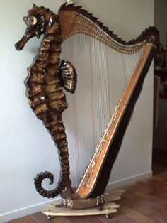 ✨  Souhail HMADI  - harpe hippocampe art bois marqueterie, 257 h de travail objet d'art décorativ, non fonctionnel comme instrument de musique  ::: Sea Horse Harp Wood Art Deco Object, non-functional as music instrument, took 257 h of work,  H 180, W 150 cm