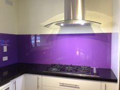 Beautiful purple coloured glass splashback!