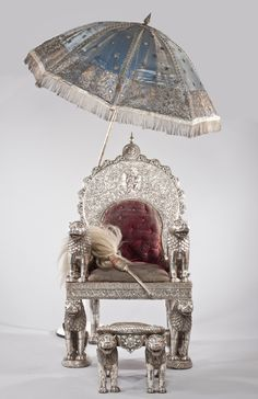 One of a pair of two silver thrones, two stools, a parasol and a flywhisk Made for the Maharaja and Maharani of Dungarpur Inscribed 'Raj Dungarpur, san 1911' Rajasthan, India Dated 1854-55 AD