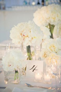 white deconstructed centerpieces and candles ... I'm all about lighting