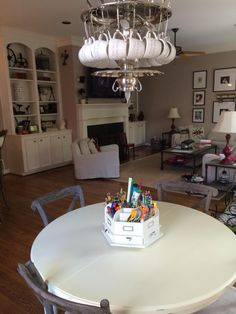Our tea party upcycled chandelier crafted from a vintage tea service. Our clever customer changed out the vintage tea cups for double espresso coffee cups to hang over her breakfast nook!  EuroLuxHome.com