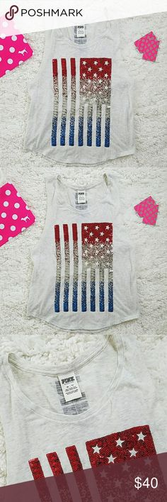 Victorias Secret PINK American Flag Bling Tank USA Victoria's Secret PINK American Flag Bling Tank Top Size xs  Red, silver, blue sequins  Stars & stripes flag design Some light pilling Muscle tank style: arm holes are raw cut (no seams) as you can see in photos. & they are cut low so a cami or bralette can peek out :)   60% cotton, 40% polyester Measurements laying flat & unstretched Top of shoulder to bottom approx. 24 inches Underarm to underarm approx. 17.3 inches Bottom edge of shirt…
