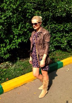Match a leather jacket with a floral dress