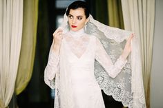 Spanish wedding gown, long sleeves, lace, white, swing, red lipstick, red nail polish | A Very Beloved Wedding | Photo: Claire Morgan | Gown: Jose Miguel Valdivia #weddinggown #lace