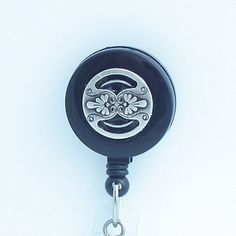 Decorative #Pewter Button on Black Magnetic Retractable Badge Reel - has a #Celtic feel to it. Handmade ID Badge Lanyards, Badge Reels, Eyeglass Chains | Plum Beadacious