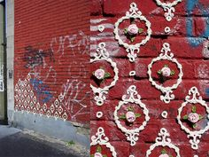 Montreal based artist Shelley Miller challenges the rough and gritty world of graffiti with her cake icing graffiti. Instead of the usual tags and throw ups Miller brings to the streets a delicate floral touch more likely to be found on triple decker wedding cake from the victorian era.
