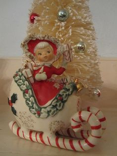 Vintage Christmas ceramic sleigh and girl..photo by belleflower29 on flickr.