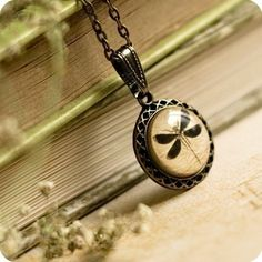 Love old parchment drawings encased into a necklace. I want to learn how to make these.