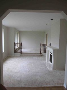 Dated look of sunken living room changed by removing rails, widening step and new flooring Living Room Update, Home Living Room, Living Room Interior, Interior Design Living Room, Kitchen Interior, Family Room Walls, Sunken Living Room, Basement Remodel Diy, Farmhouse Remodel