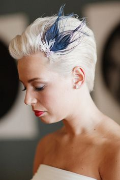 something blue. Cool idea for short wedding hair... I like the short hair style but minus the ugly blue feather ; )