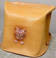 "Repujado hiper realista. Bag made from a kitten? Would that make it a ""Kitten-Kaboodle""?"
