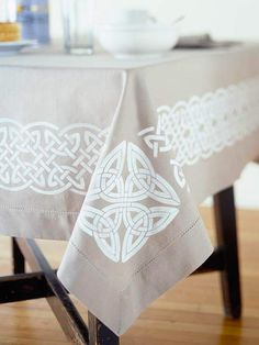 This pretty Celtic-inspired table cloth can be used long after St. Patrick's Day festivities. See more ways to decorate for St. Patrick's Day: http://www.bhg.com/holidays/st-patricks-day/decorating/st-patricks-day-decor/?socsrc=bhgpin030413celtictablecloth=13