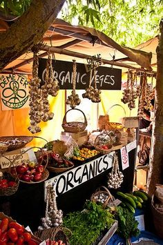 Lammas is a celebration of the first harvest, the garden harvest.  County fairs and farmer's markets are the place to be in August.  [This is Black Barn Farmers Market, Hawke's Bay, New Zealand].