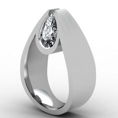 Pear Shaped Diamond Ring, Tip facing up set in platinum. Made by Paul Bieker. OMG I SOOOOO DIG THIS (Mena =)