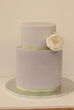 cake from hello naomi lavender cake with light green ribbon trim