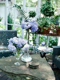 Here are two different ways to arrange a handful of lilacs.  -- Tall: Keep the stems long and grab a few tall pieces of greenery. Place in a narrow vase letting the greenery rise above the flowers.  -- Short: Cluster the lilacs in your hand and cut to the height of a narrow-mouth vase. Put the flowers in the vase solo, or tuck greenery near the base of the arrangement.