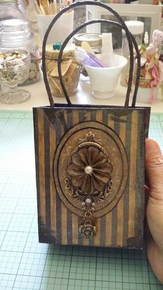 Altered gift bag in the Tim Holtz grunge style.