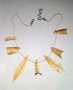 Necklace | Alexander Calder. Bone, brass and string. ca. 1945. || Photo Credit: Calder Foundation, New York