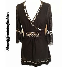 """Black & White Tunic Black tunic with white embroidery and amber toned beaded embellishment. Front (lined) and sleeves are a mesh-like fabric and the back knit. Approximate measurements laying flat: Bust 16"""" Waist 15"""" Hips 16"""" Length (from shoulder) 30"""". Adorable! Shelly M. Couture Tops Tunics"""