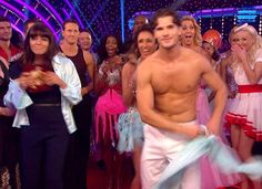 Hello ladies! Gleb Savchenko rips off his shirt prompting admiring glances from Claudia Winkleman (left)