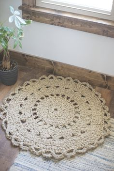***You can find the PDF version of this pattern in my shop by clicking here. Great for easy printing!*** Let me start this post by saying that I am SO excited to get this rug out into the world. Ever since I spotted those beige sheets in Walmart on sale for $4.50, I knew I could come up wi
