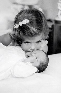 3 year old Caroline Kennedy kisses her baby brother, JFK Jr. 1960... So cute I just had to pin!