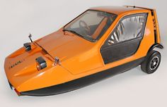 1974 RELIANT BOND BUG - The Bond Bug was a small British two seat, three wheeled sports car of the 1970s. Following the purchase of the Bond Motor Company, Reliant commissioned Tom Karen of Ogle Design to design a fun car. It was a wedge-shaped microcar, with a lift-up canopy and side screens instead of conventional doors. The Bond Bug was based on the Reliant Regal chassis and running gear. The original concept was explored by chopping down a production Regal vehicle.