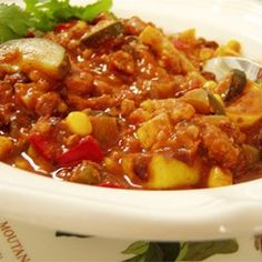 Chili cooked in a pressure cooker is fast, and the spices and unsweetened cocoa give it a rich flavor.
