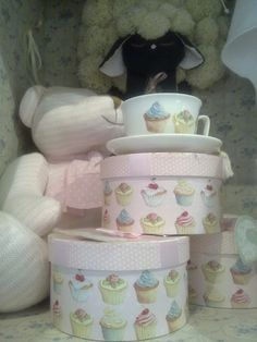 I like the idea of the cute round boxes. Could hold random baby items or shoes, socks, washcloths, etc. for small storage