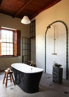 "The large master bathroom features a cast-iron bateau bathtub and a generous shower area. ""Space is holy,"" says Jacques. ""And a bathroom should not be diminished. It is as important as the space where you rest."""