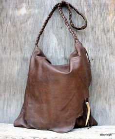 Hey, I found this really awesome Etsy listing at http://www.etsy.com/listing/159642540/rustic-leather-bag-with-deer-antler-tip