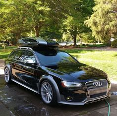 Black Audi Allroad with rooftop carrier